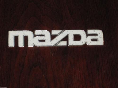 Mazda orig. white faced CAR BADGE chrome/plastic 22mm high 130mm long,FREE POST