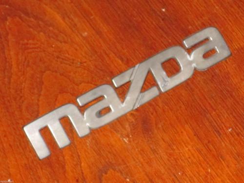 Mazda original worn face CAR BADGE black plastic 158mm long, 27mm high FREE POST