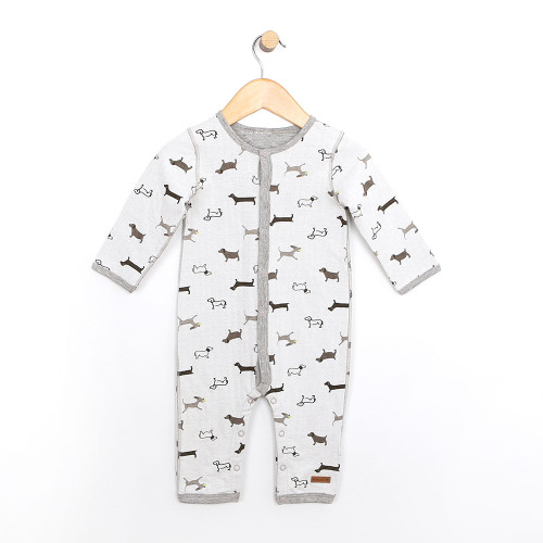 Baby coverall.  This long sleeve one piece is reversible.  White printed with a dog pattern and grey heather on the other side.