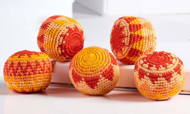 Squeeze this orange and red crochet ball to release a relaxing citrus scent.  Citrus Scent Stress Relief Ball Cotton Thread, Polypropeline, Wood Ball, Orange Scent.
