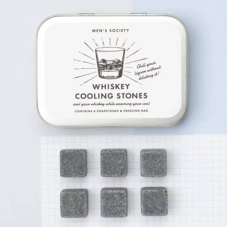 WHISKEY COOLING STONES  These re-usable cooling stones are the perfect gift for anyone who loves a tipple of whiskey. Part of our range of award-winning gifts for men, they are designed to be both fun and functional. Each cooling stone is chiselled from volcanic rock for a cool, sophisticated way to enjoy a glass of malt. Each gift set contains six whiskey cooling stones.