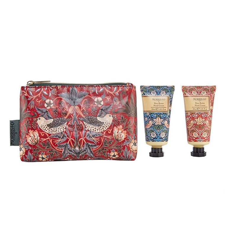 William Morris Strawberry Thief Hand Care Bag.  Two Shea Butter hand creams, blended with Vitamin E, Cocoa Butter, Lemon and Aloe extracts, Jojoba oil and Macadamia oil for deep, velvety, easily absorbed moisturising, enclosed within a beautifully decorated wash bag.  Infused with fragrances of rich earthy base notes of Amber, Sandalwood and Patchouli, topped with refreshing notes of red berries and bergamot on a heart of Rose for a sensory treat steeped in English history.