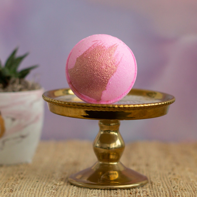 Strawberry Champagne Bath Bomb This sweet creation is inspired by Strawberry Champagne, pink with a shimmery rose gold finish! A sweet blend of red fruits boosted by lily of the valley and apple cider. Cruelty Free. Made with Biodegradable and Renewable Ingredients. Vegan.  Made in United States of America