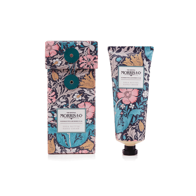 William Morris 100ml Pink Clay & Honeysuckle Hand Cream. Add luxury to hand care with this scented hand cream, adorned with the romantic Compton print. The crafted formulation is enriched with pink clay, shea butter, jojoba and macadamia oils to help leave hands feeling velvety soft. Its mineral-fresh, floral fragrance with honeysuckle, amber and comforting powdery notes leave hands delicately fragranced. Encased in a rigid box decorated with the romantic design and finished with a fine, cord fastening.
