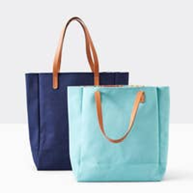 """Cotton Canvas Tote With playful interior prints, there's more to this tote than meets the eye. Made cotton canvas with a poly printed lining. 17.5""""W x 5.5""""D x 16""""H. Vegan leather handles with 9"""" drop, interior print: poppy floral, inside pocket: 6""""w x 6"""" h."""