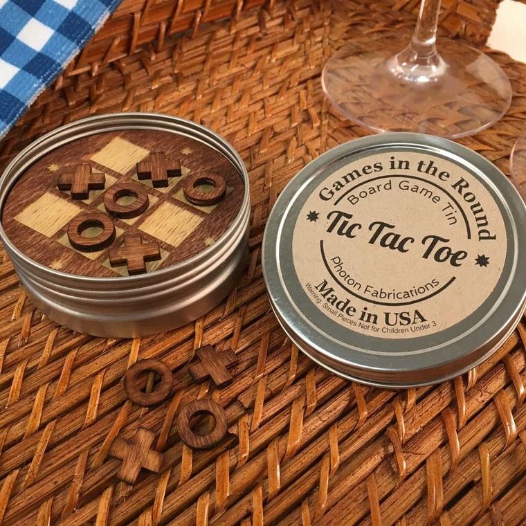 """Good old fashioned board game fun re-imagined in round retro travel tins. Available in tic-tac-toe. Made in the USA. 3.25"""" x 1"""". Made in United States of America"""