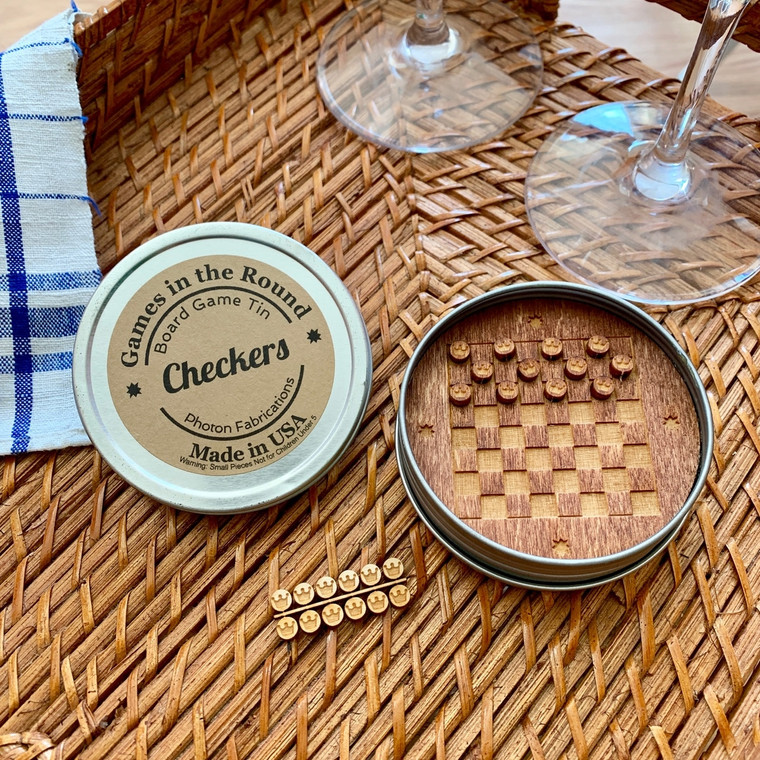 """Checkers Good old fashioned board game fun re-imagined in round retro travel tins. Made in the USA. 3.25"""" x 1"""". Made in United States of America"""