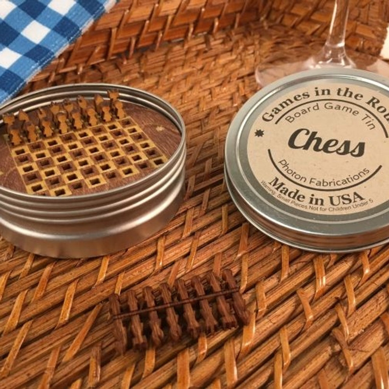 """Chess  Good old fashioned board game fun re-imagined in round retro travel tins. Made in the USA. 3.25"""" x 1"""". Made in United States of America"""