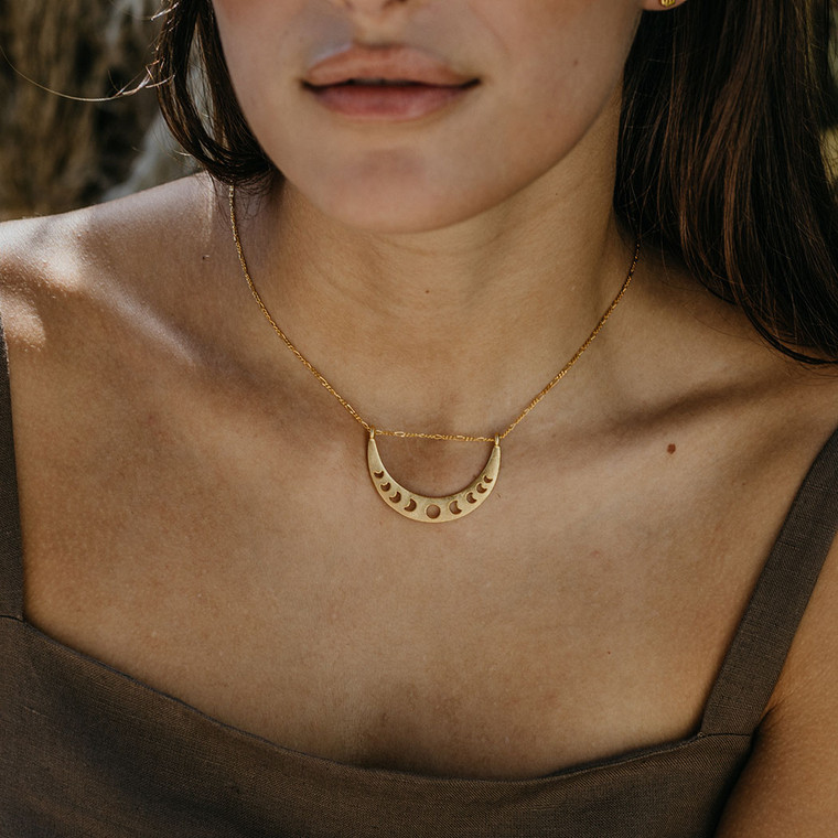 """Phases of the Moon Necklace  This crescent is threaded on 16"""" barley chain with a 2"""" extender so you can adjust it to the perfect length! 14k gold over brass. Made in United States of America"""