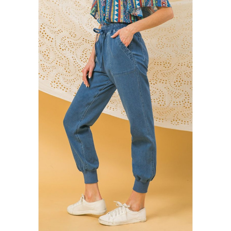 """Our denim joggers feature an elasticized waist with tie and side pockets  Details Self: 80% Cotton 15% Polyester 5% Spandex Contrast 95% Cotton 5% Spandex  Size & Fit - Model is 5`8"""" And Wearing Size Small -  Measurements Taken From Size Small - Approx. Length: 39.5"""""""