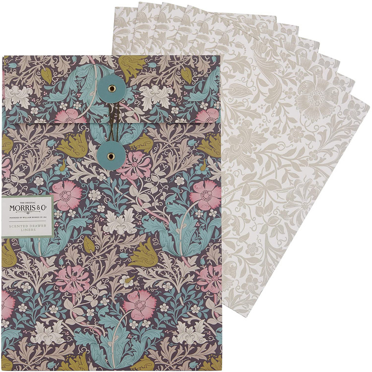 William Morris Pink Clay & Honeysuckle Scented Drawer Liners (5 Sheets).  Add a touch of scented, heritage style to drawers and cupboards. Each of the five scented drawer liners is decorated with the Compton pattern and infused with fragrance to delicately scent drawers, shelves, cupboards and clothes.  Enjoy delicate scents where mineral elements merge with sparkling top notes of honeysuckle blooms, rose and jasmine. Grounded on an earthy base of amber, with comforting powdery notes.