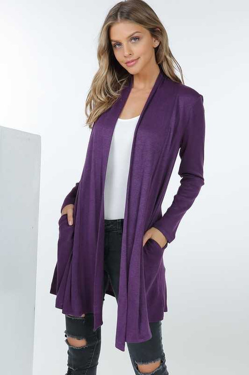 This gorgeous mid-length cardigan with pockets should be a staple in your closet. Available in Black, Navy, Eggplant & Wine. Available in S,M,L & XL.