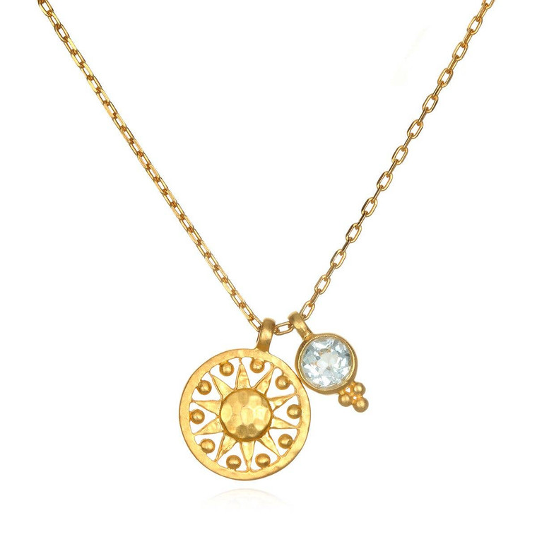 A glimmering blue topaz improves communication, imparts wisdom and ignites love in its wearer. Sun: vitality, leadership, life. Blue Topaz: communication, wisdom, love. 18'' length. 13mm round. 18 karat gold plated brass.