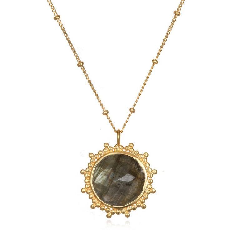 This necklace features a labradorite pendant, stone of imagination, perseverance and truth, cradled by 18k gold plate sun rays to illuminate your path.   Labradorite: imagination, perseverance, truth. 18'' - length. 18 karat gold plated brass.