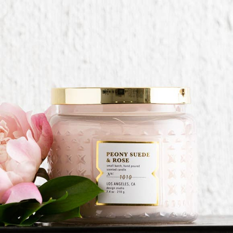 This fragrance features an intoxicating blend of pink peony blushed suede and crushed rose petals. Retro pharmacy jar.  These curated candles are hand crafted and hand poured.
