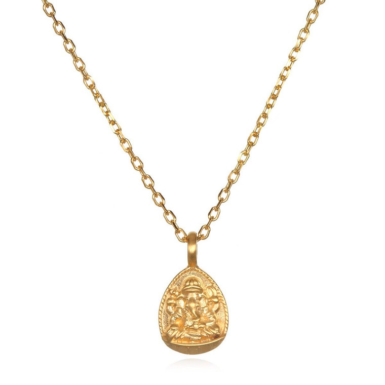 """An 18k gold plate Ganesha pendant, remover of obstacles and bestower of success, dangles from a delicate gold chain for a necklace to accompany your journey. Ganesha: success, remover of obstacles. 18"""" – length. 18 karat gold plated brass."""