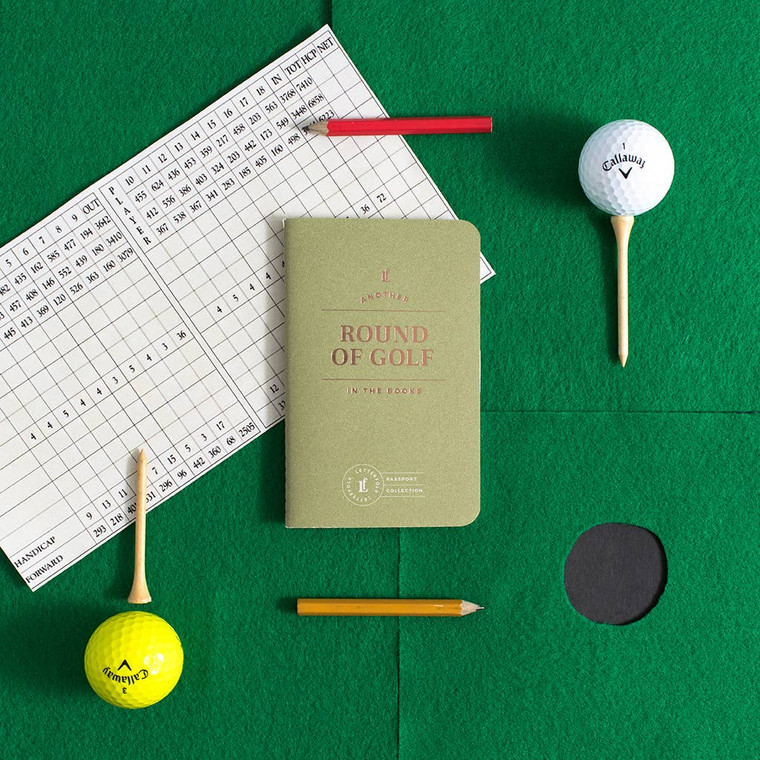 "Round of Golf Passport Journal  Designed to capture and encourage experiences, each passport contains 20 entry logs with relevant form fields to help capture meaningful details of each theme-specific experience. Specs: acid-free 60lb text, stippled cover, foil stamped, center-sewn binding. Size: 3.5"" x 5.5"""