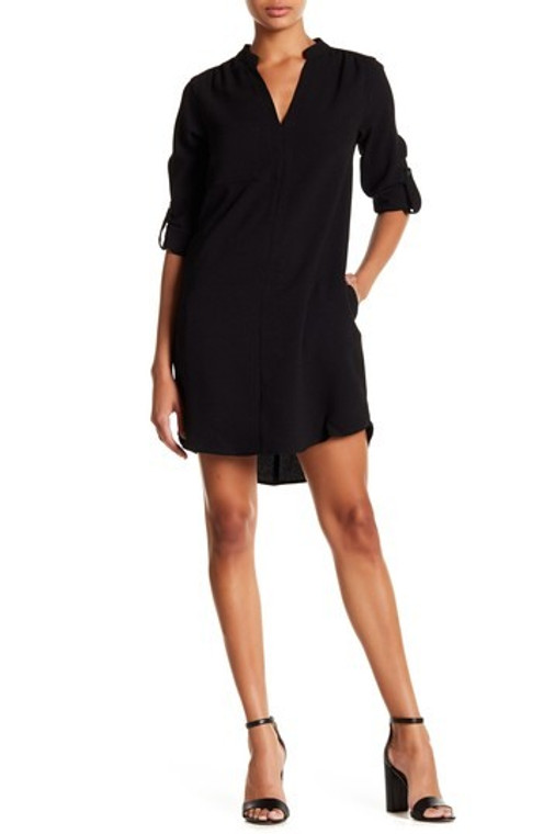 This classic shift dress is an easy comfirtable fit for the summer. Rolled up sleeves with button and pockets. The hem line is a slight high low.