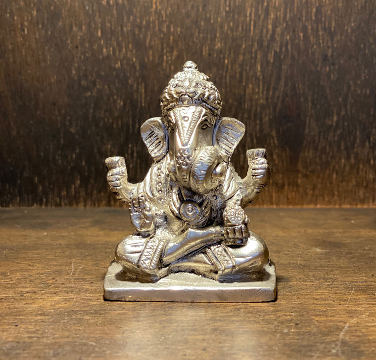 Ganesha is widely revered as the remover of obstacles, the patron of arts and sciences and the deva of intellect and wisdom. As the god of beginnings, he is honoured at the start of rites and ceremonies. He is the younger son of Lord Shiva and Goddess Parvati.  This Brass Ganesh Statue was handmade in India Statue Height: 2.75 inches