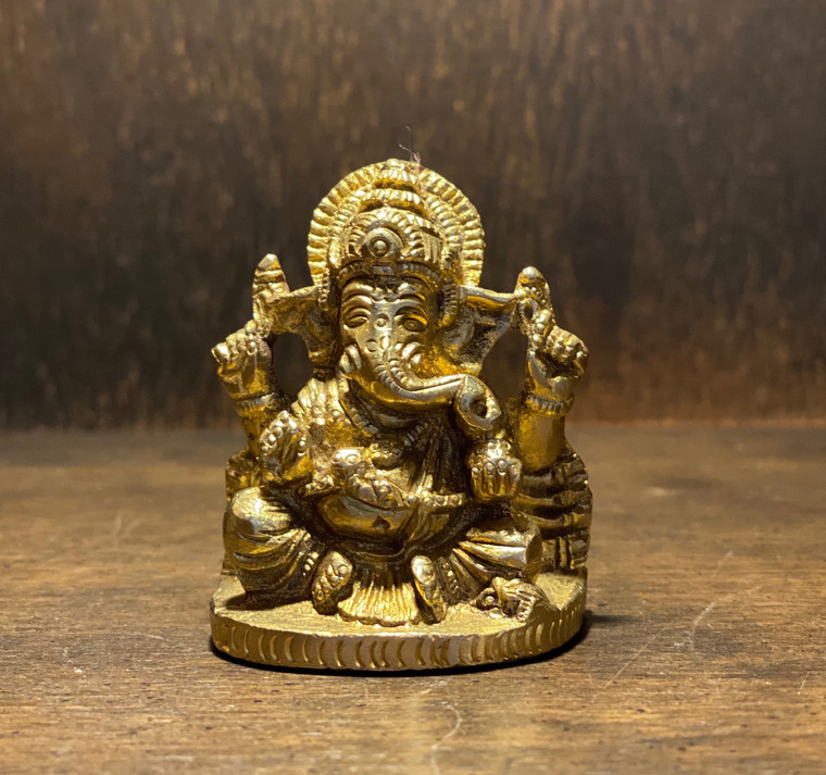 Ganesha is widely revered as the remover of obstacles, the patron of arts and sciences and the deva of intellect and wisdom. As the god of beginnings, he is honoured at the start of rites and ceremoniesand is prayed to particularly when people are beginning a new enterprise or starting a new business or moving into a new house. Ganesh is also known as the patron god of traveling. He is the younger son of Lord Shiva and Goddess Parvati. This Brass Ganesh Statue was handmade in India Statue Height: 2 inches