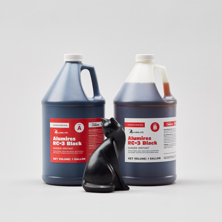 Alumilite's RC 3 AlumiRes black resin in two one-gallon bottles with a black resin cat