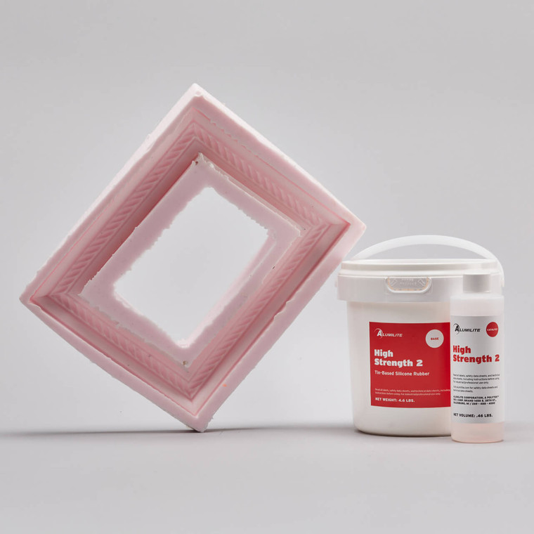 Alumilite's High Strength 2 tin-based silicone 5 pound kit with a pink silicone picture frame mold