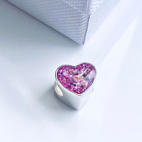 Exquisite heart charm, fits most major bracelet brands and can be made with your loved ones ashes or hair.