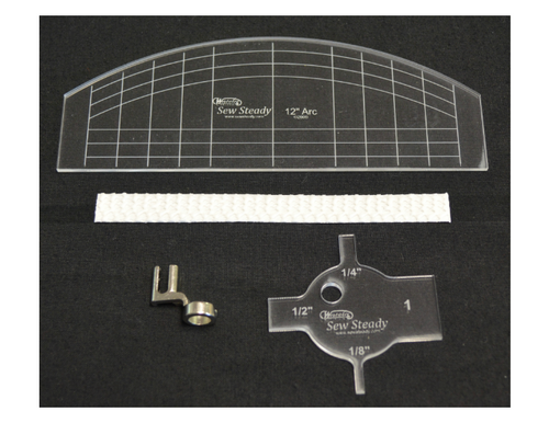 Westalee Ruler Foot Starter Package, contains 1- Westalee Ruler Foot, 1-Arc Ruler, 1-Stable Tape, 1-Spacing Gauge.