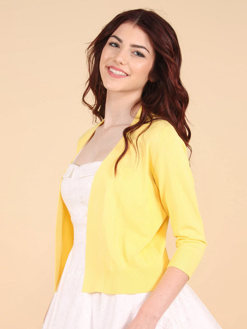 Open front quarter sleeve crop cardigan in yellow (angled)