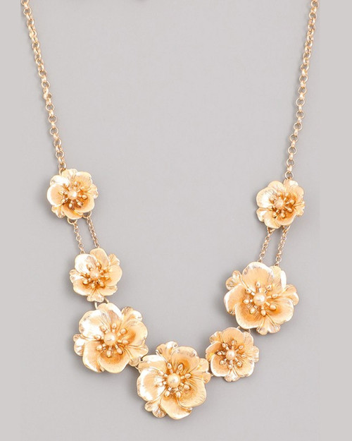 gold metal flower statement necklace