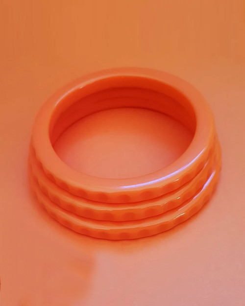 bow and crossbones imogen tangerine thin bangle