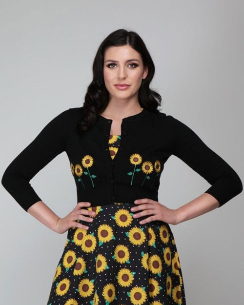 Collectif Abigail Sunflower 3/4 Sleeve Cropped Black Cardigan with yellow embroidered sunflowers - model front shot