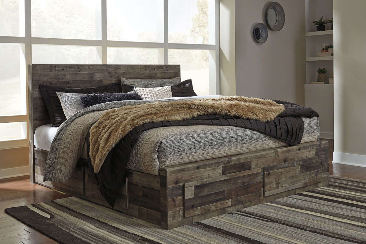 The derekson multi gray king panel storage bed available at logans furniture serving avon ma and surrounding areas