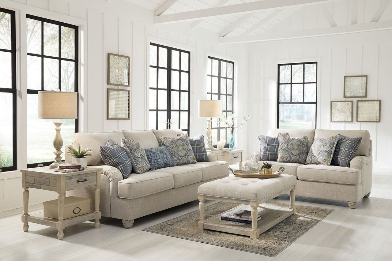 The Traemore Linen Sofa, Loveseat, Shawnalore Ottoman Cocktail Table & 2 End Tables Available At Logan Furniture Serving Dorchester, MA.