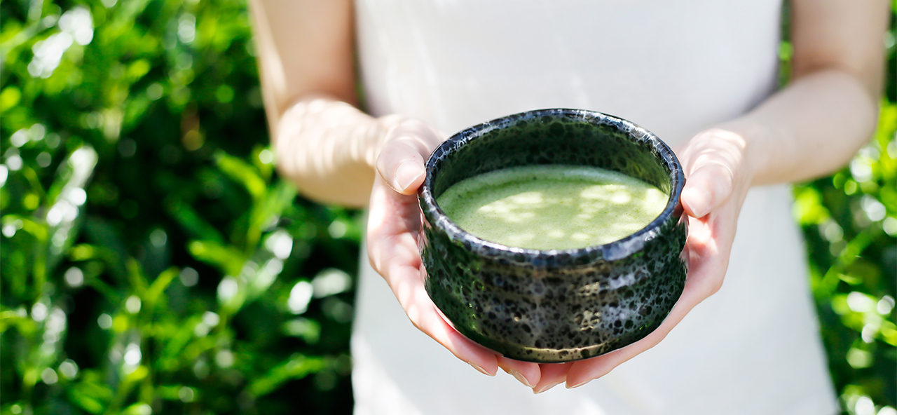 Lady Holding Green Tea Matcha in a Bowl