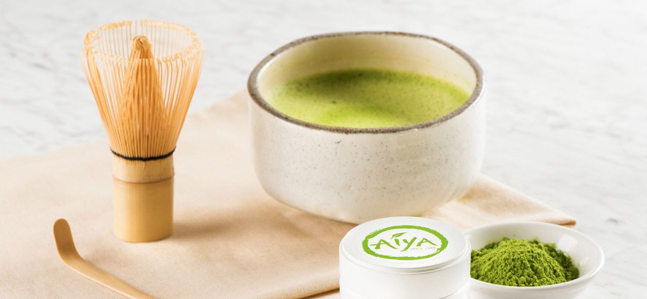 Green Tea Matcha in a Bowl with Wisk and Product Tin