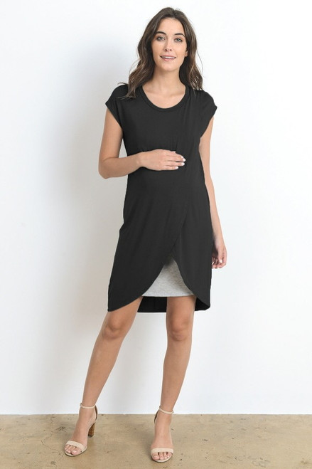 A black short sleeve maternity and nursing dress featuring a rounded neck line, an asymmetrical hem and grey underlining.