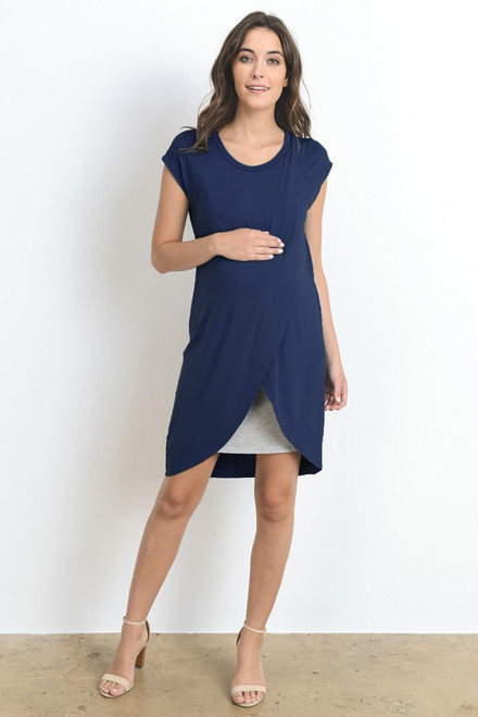 A navy short sleeve maternity and nursing dress featuring a rounded neck line, an asymmetrical hem and grey underlining.