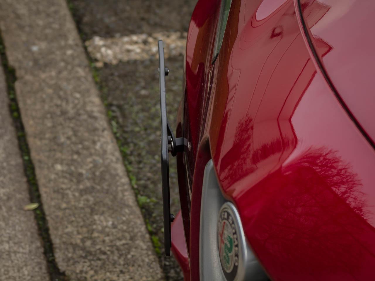 The CravenSpeed Platypus License Plate Mount installed on a 2018 Alfa Romeo Giulia Quadrifoglio.
