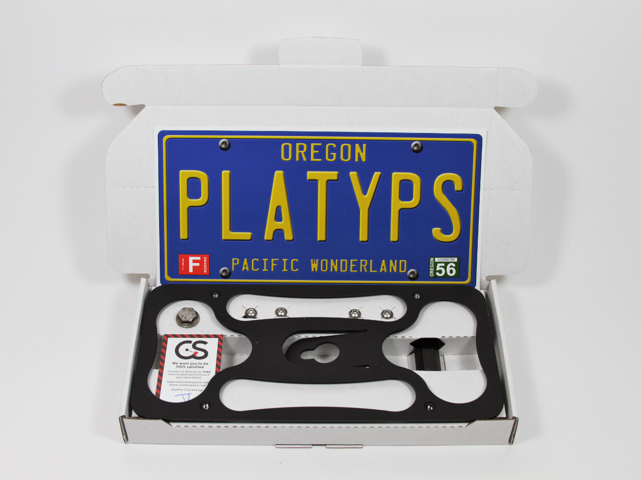 All of the parts for the Platypus License Plate Mount in their box.