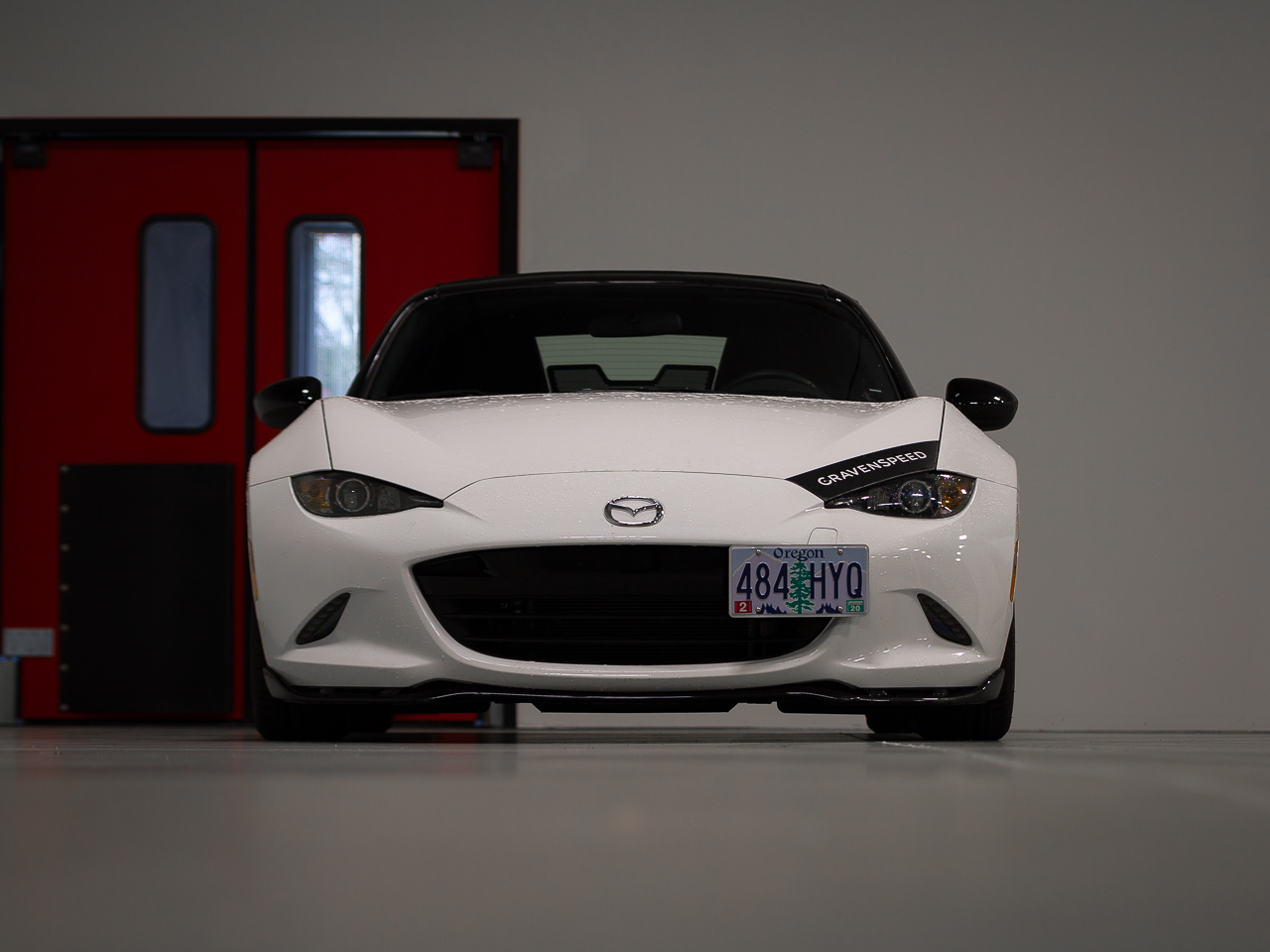 The CravenSpeed Platypus License Plate Mount installed on a white 2016 Mazda MX-5/Miata ND.