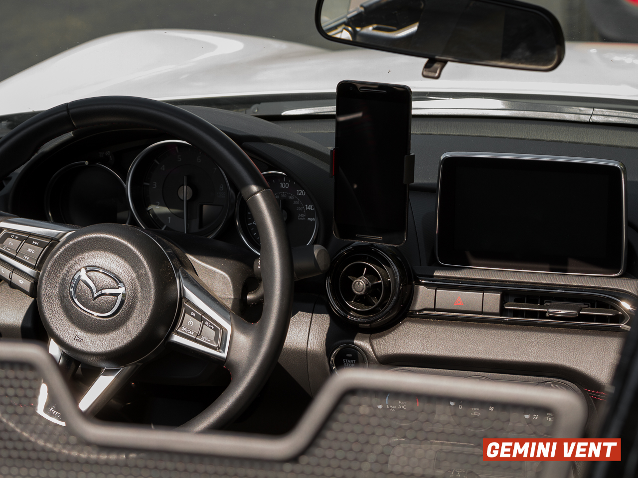 The CravenSpeed Gemini Vent Phone Mount installed in a 2016 ND MX-5 Miata  holding a Nexus 6P.
