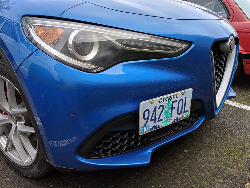 The CravenSpeed Platypus License Plate Mount installed on a blue 2019 Alfa Romeo Stelvio.