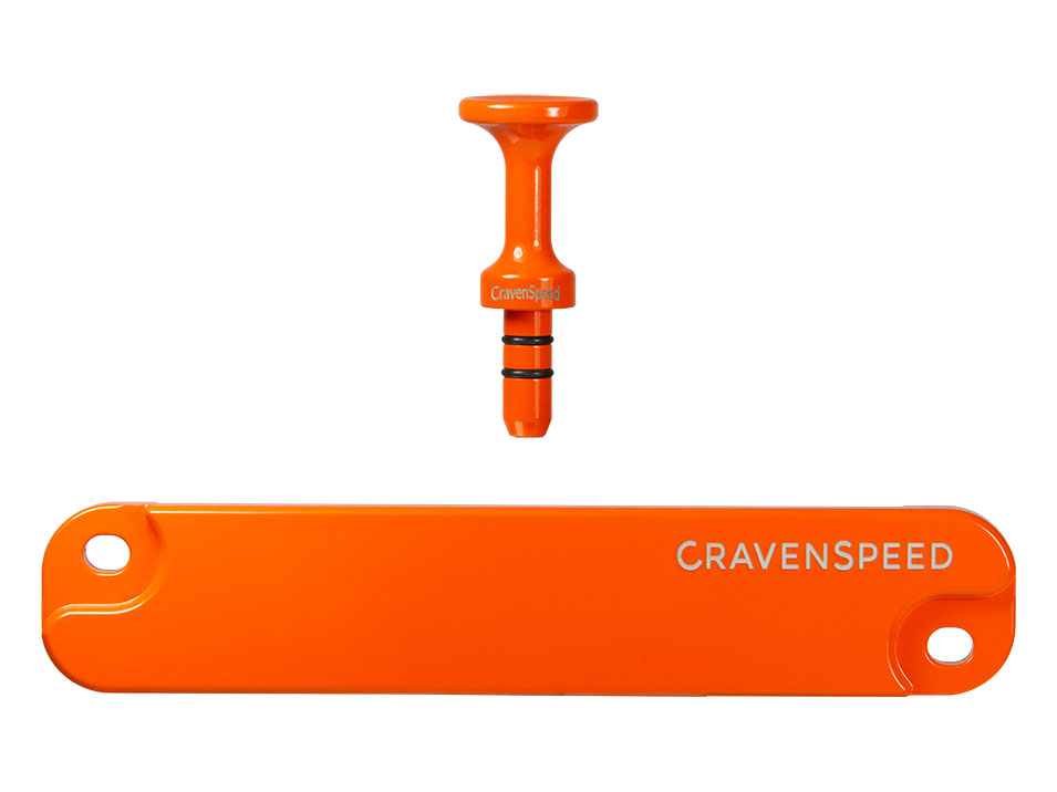 The CravenSpeed Battery Tie Down and Dipstick Handle for the ND Mazda Miata/MX-5 in 30th Anniversary Orange.