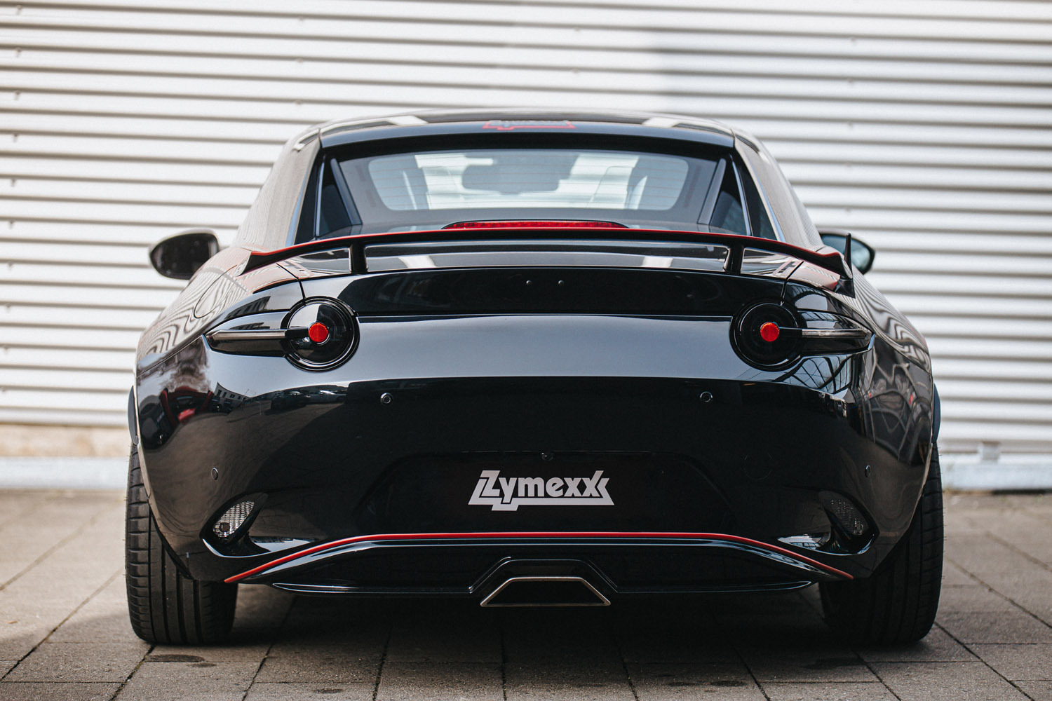 Image of Tinted Tail Lights installed on a black ND Miata