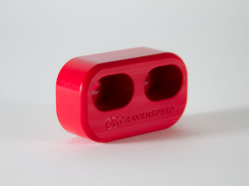 The front side of the CravenSpeed Door Bushings for the 2016-2019 Mazda Miata/MX-5 ND in red.