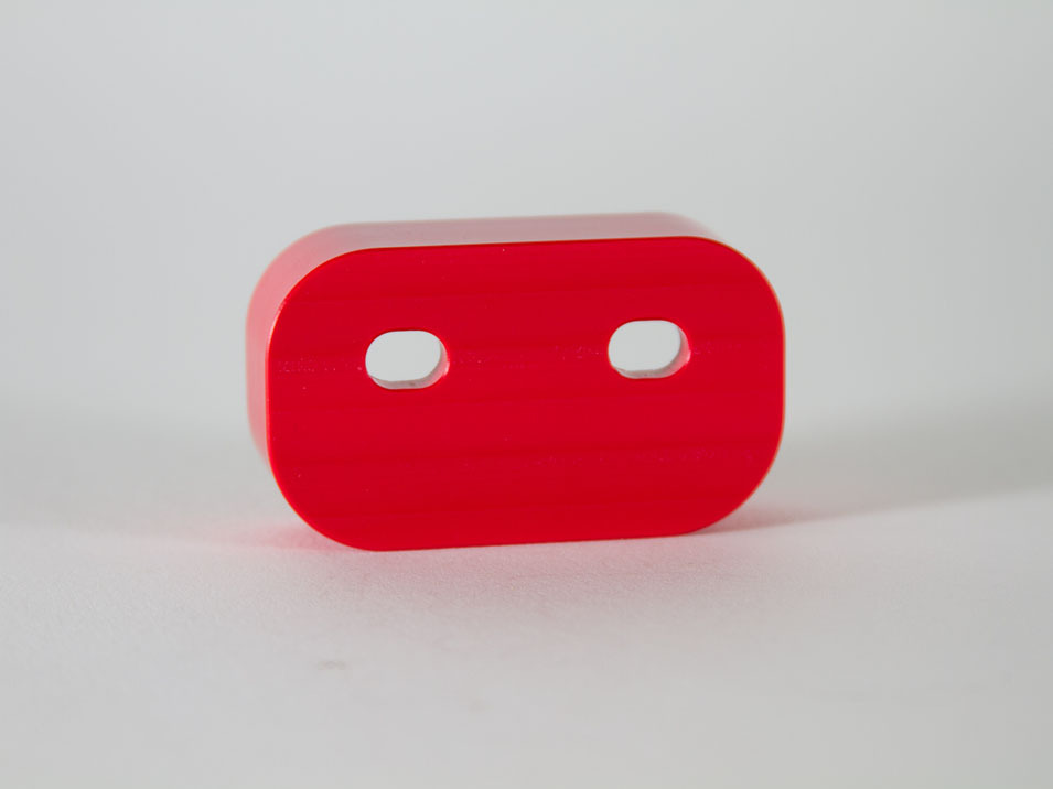 The back side of the CravenSpeed Door Bushings for the 2016-2019 Mazda Miata/MX-5 ND in red.