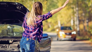 Young woman with a car breakdown