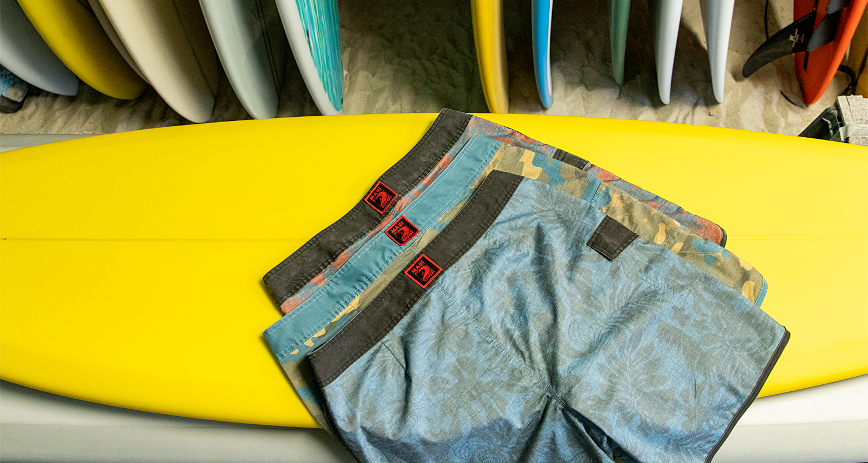 "Maui Rippers Men's 19"" vintage stretch boardshorts in surf shop"