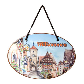 "This charming ceramic door sign or wall hanging features a cork backing and two holes with a rope allowing one to hang the sign up right away (hook not included). Door sign comes in a gift box. Features the German saying: ""Willkommen"" accented with artwork of Rothenburg. Approximate Dimensions (Length x Width x Height): 11.5x0.25x8"" Material Type: Ceramic"